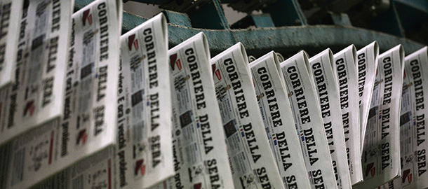 The edition of the November 8, 2012 of the Corriere della Sera newspaper, with its frontpage on the results of the US presidential election is being printed on November 8, 2012 at the newspaper printing house in Milan. Founded in 1876, the Corriere della Sera is one of the main Italian daily newpspaper, with its offices located Via Solferino in Milan, in the same buildings since the beginning of the 20th century.  AFP PHOTO / GIUSEPPE CACACE        (Photo credit should read GIUSEPPE CACACE,GIUSEPPE CACACE/AFP/Getty Images)
